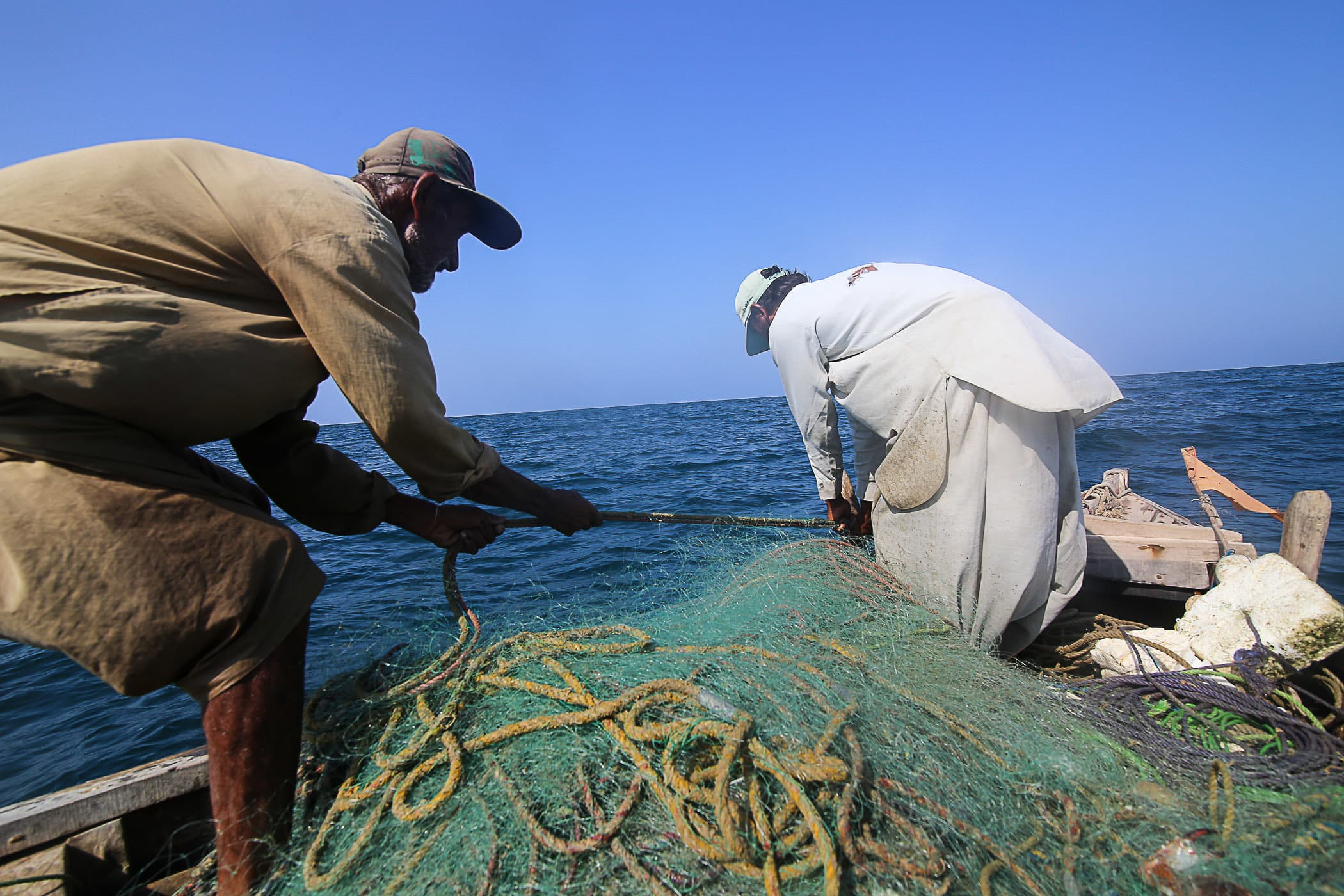 Sometimes the nets get tangled in the rocky seabed and a strong yank is required to dislodge it.