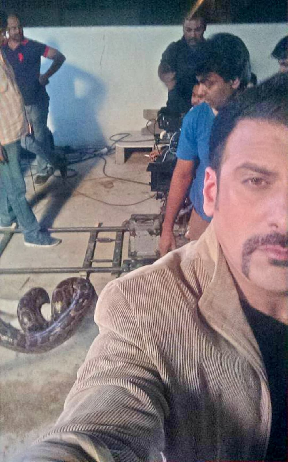 Is that a real snake on the set? – Photo courtesy Shamoon Abbasi