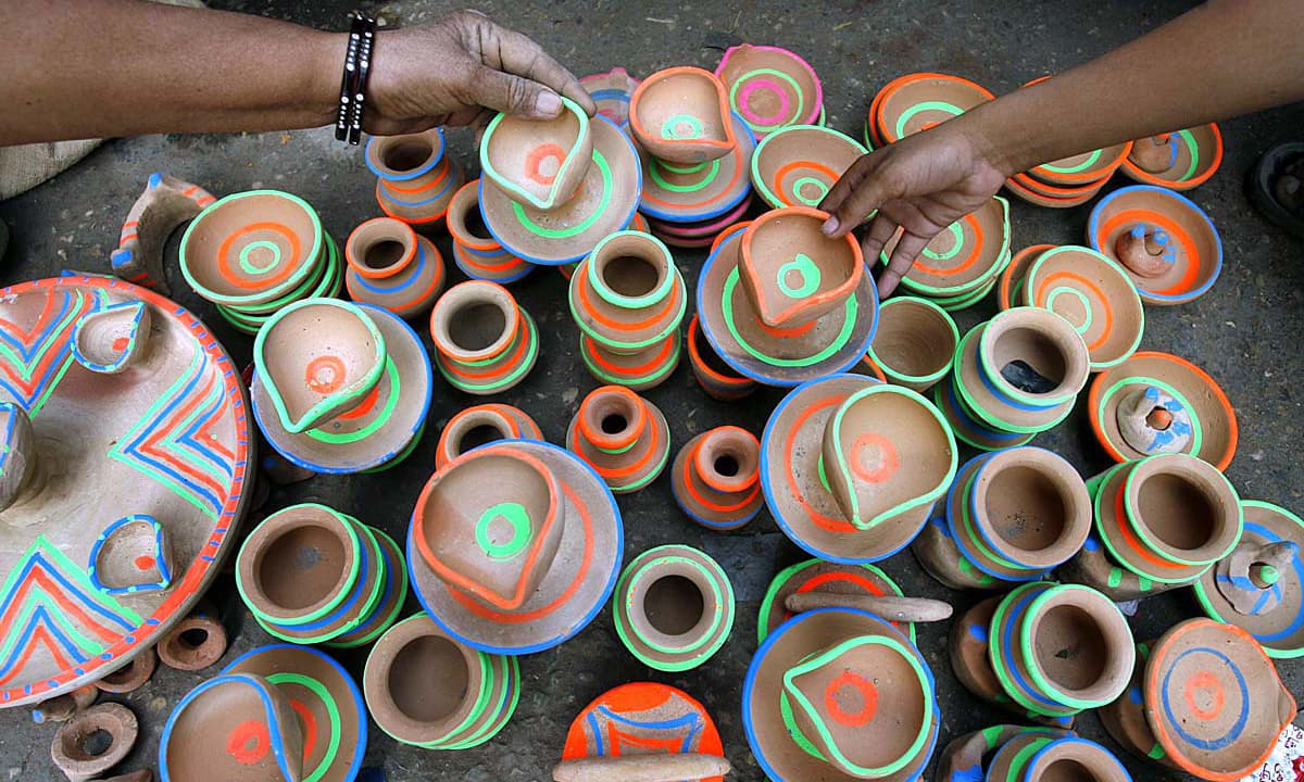 A vendor displaying the earth lamps to attract the Hindu community customers to be used during their religious Festival Diwali. —APP