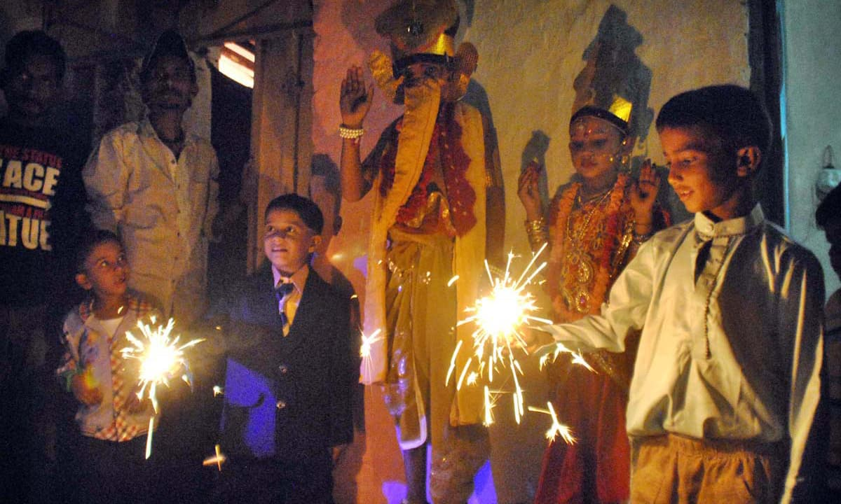 Children celebrate Diwali festival. —APP