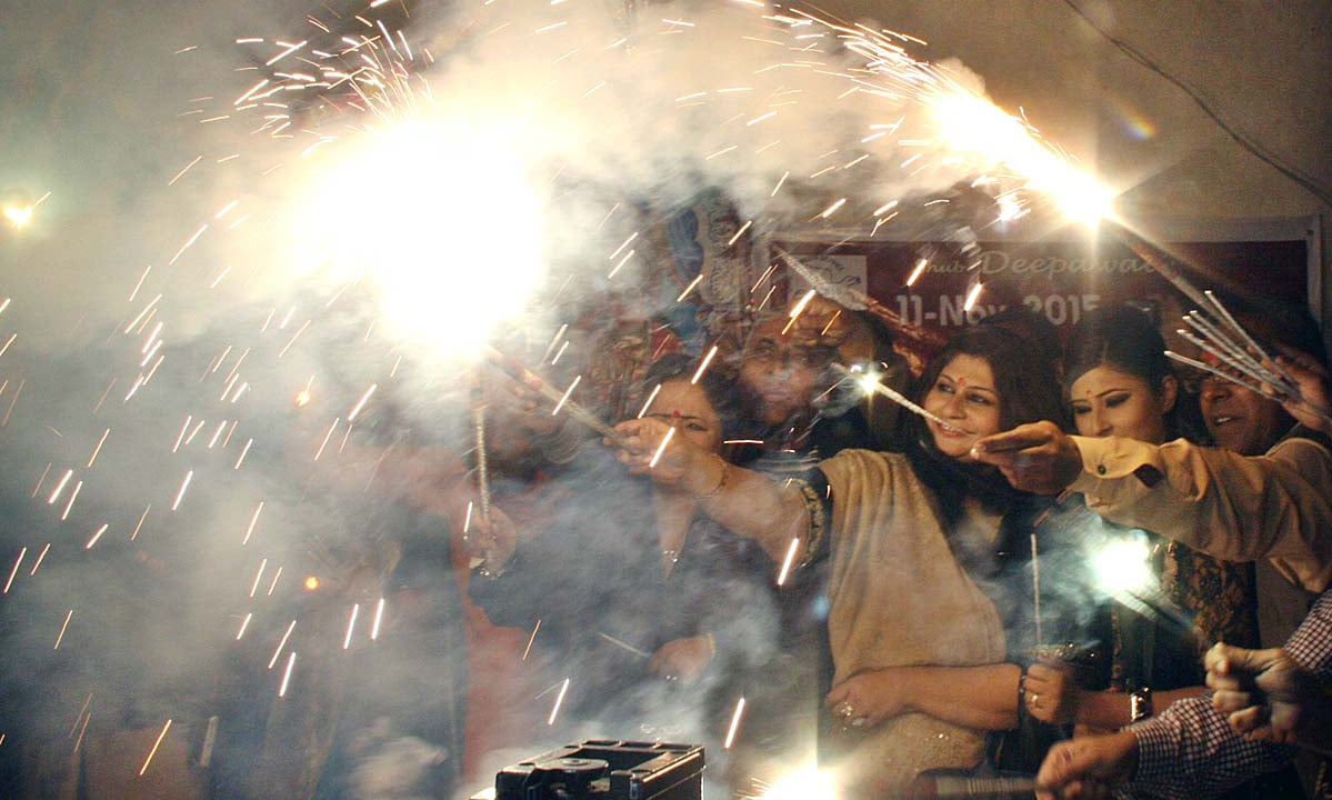 Hindu family celebrates Diwali festival at Balmic Mandir. —APP
