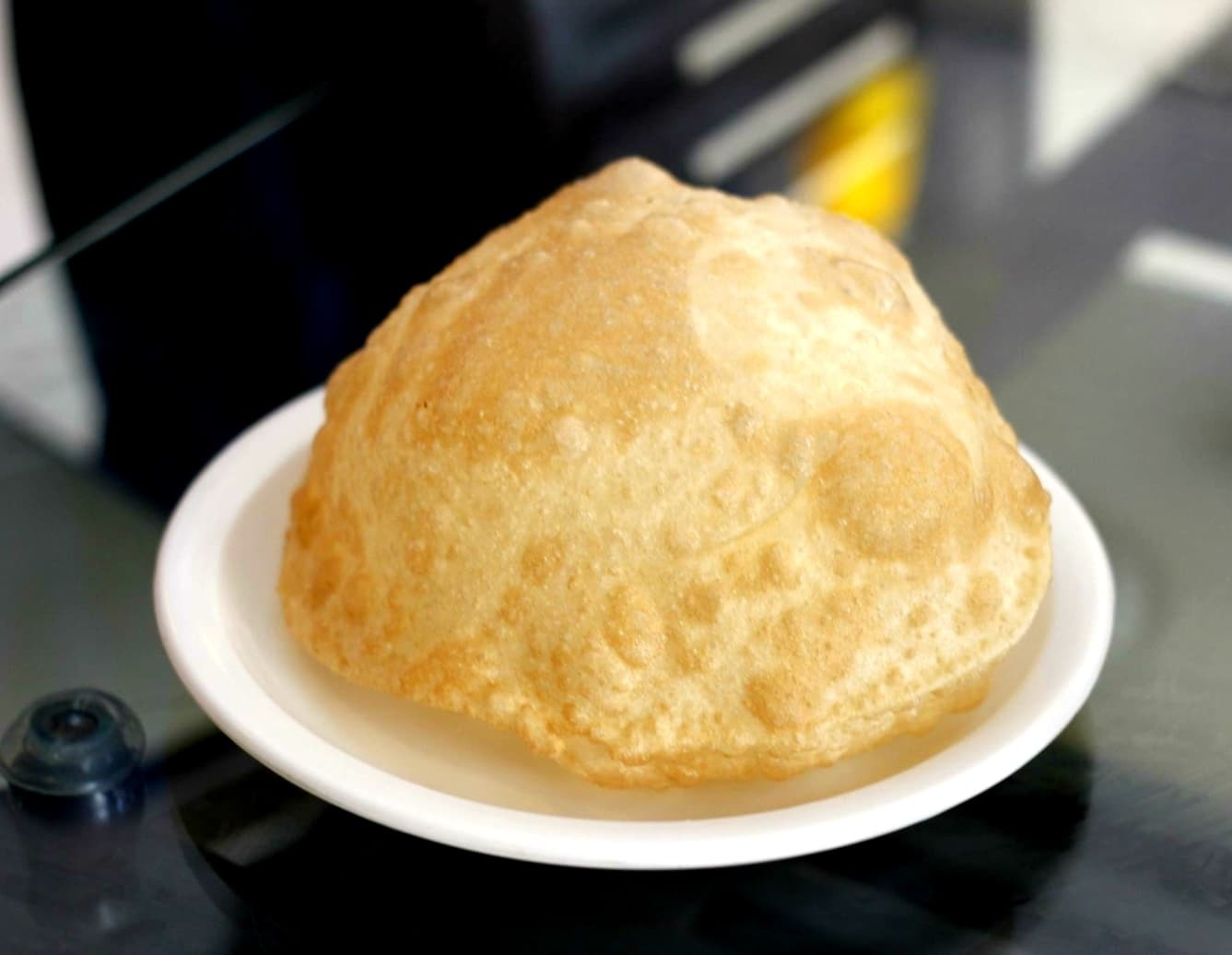 One couldn't help but pop this puri bubble the minute it arrived on the table
