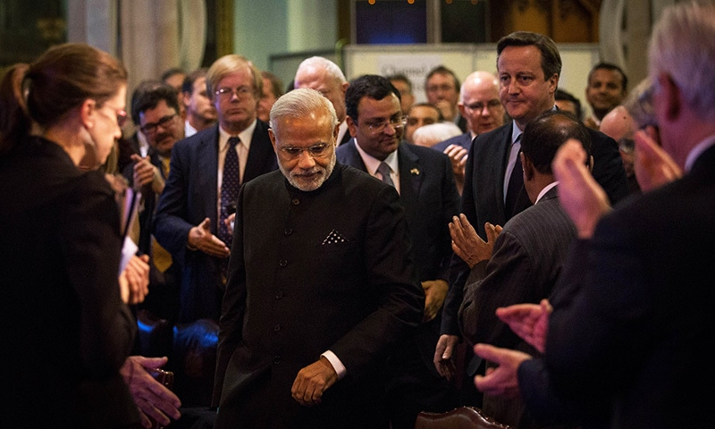 Indian Prime Minister Narendra Modi (C front) and British Prime Minister David Cameron (R back) arrive for an event at the Guildhall in London on November 12, 2015. —AFP