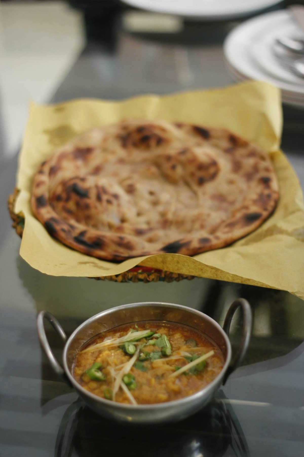 CnC's parathas are served with daal enriched with desi ghee