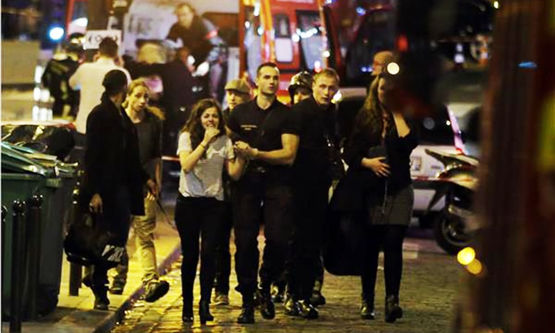 Rescuers evacuate people following an attack in the 10th arrondissement of the French capital Pari.—AFP