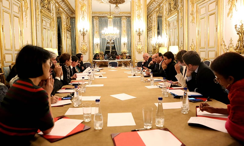 In this handout picture receivced from the French Presidents office French president Francois Hollande (5-R) addresses an emergency meeting at the Elysee Palace early on November 14, 2015 after a series of attacks occurred across Paris. —AFP