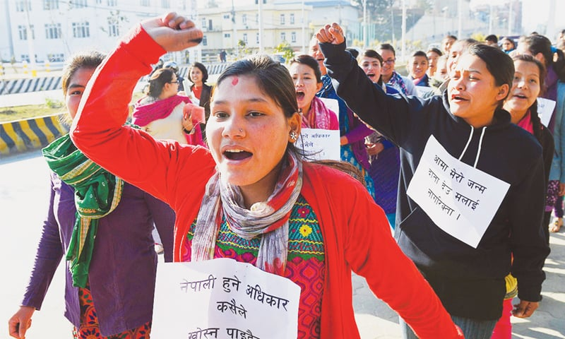 NEPALESE protest against the new constitution in Kathmandu on Jan 19.—AFP