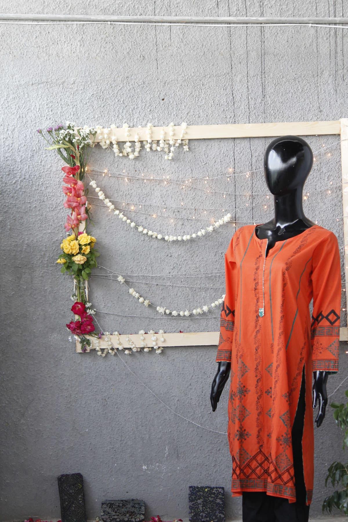 An orange stitched kurta costing Rs 3900.