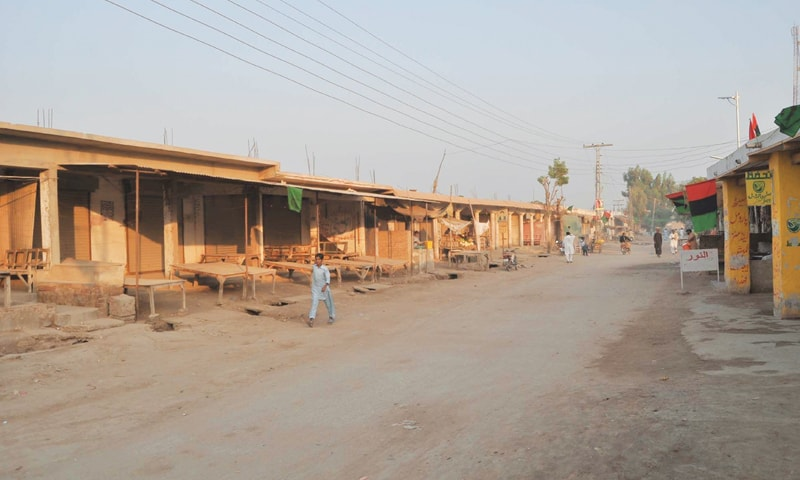 The main bazaar of Khadro — a small town in Sinjhoro taluka — was deserted on Nov 13 during a strike following the killing of the son of a PPP candidate for a Sanghar district council seat. —Photo by Yousuf Nagori