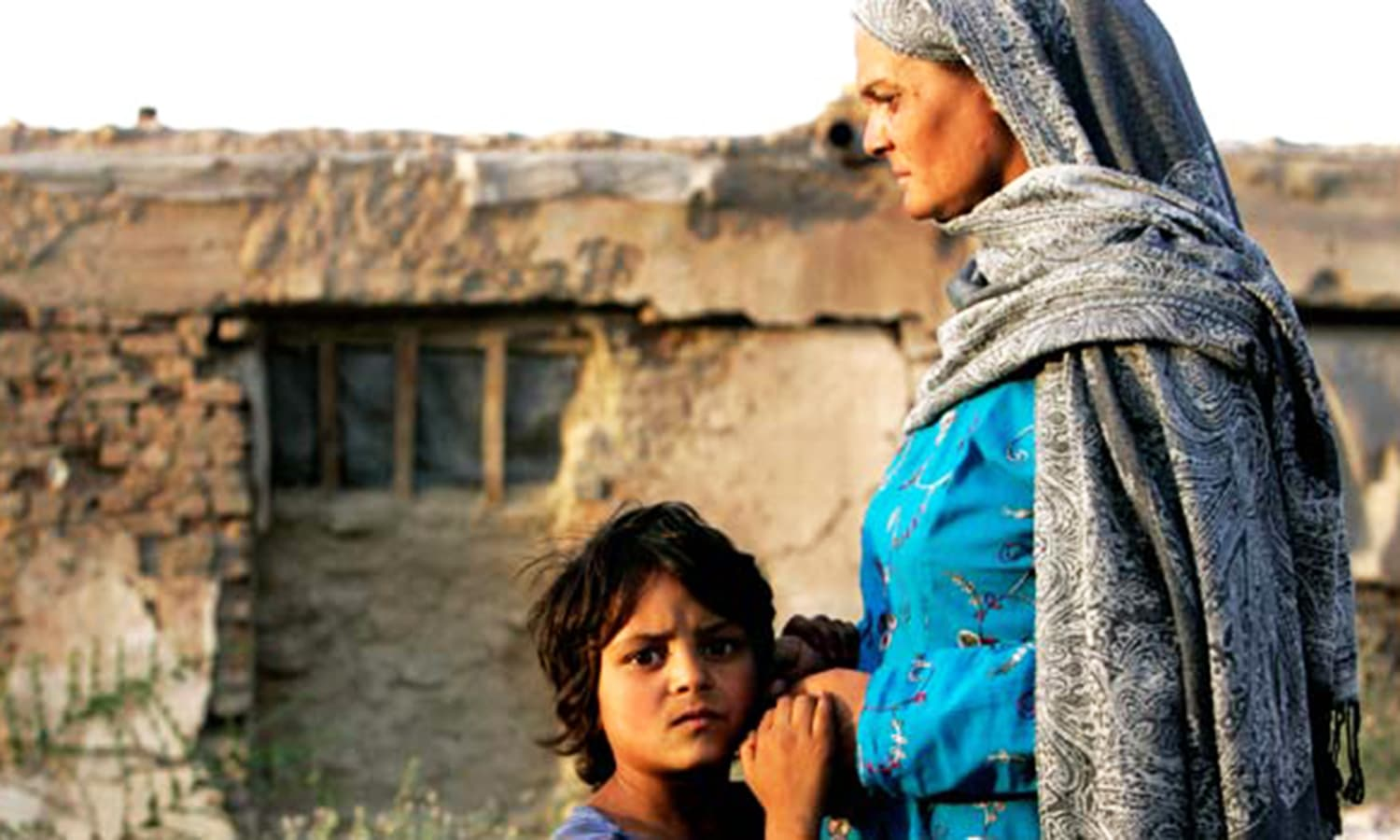 Afghan refugee Shapera, right, stands with her daughter. – AP/File