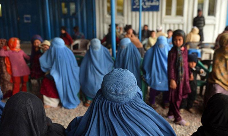 Afghan refugees at a UNHCR registration centre in Peshawar. – AP/File