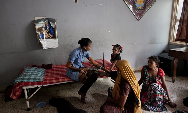 A nurse takes the blood pressure of a surrogate mother in a dormitory run by Akanksha Clinic, one of the most organised clinics in the surrogacy business, in Anand, India. — AP