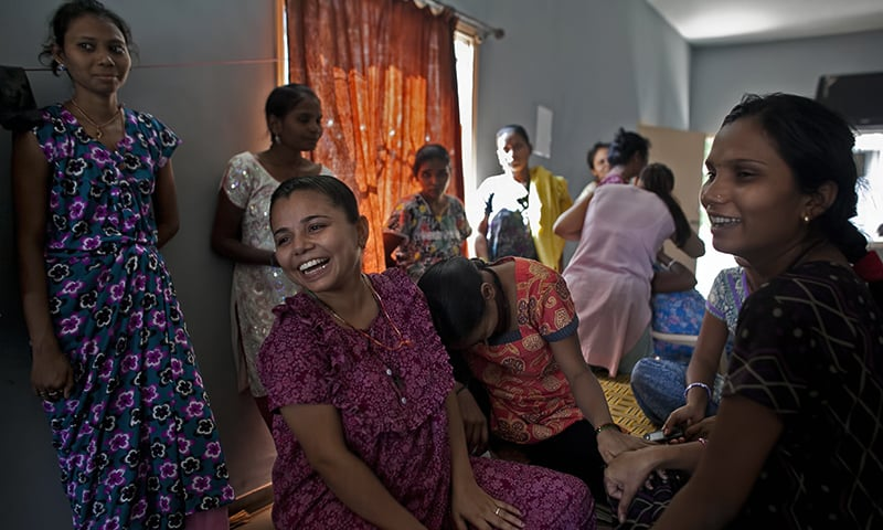 26-year-old Christina Christian, centre left, socialises with other surrogate mothers at a dormitory run by Akanksha Clinic in Anand, India. — AP