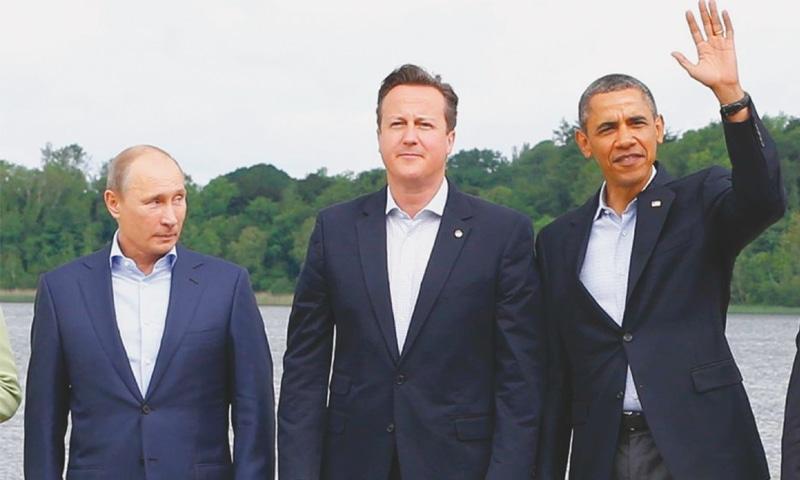 Russian President Vladimir Putin (left), UK Prime Minister David Cameron (centre) and US President Barack Obama.