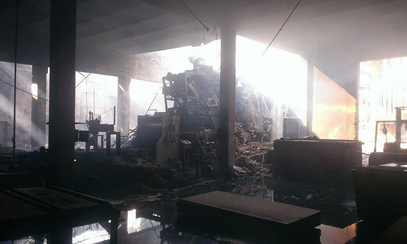 Aftermath of the factory fire. —Amir Kayani/File