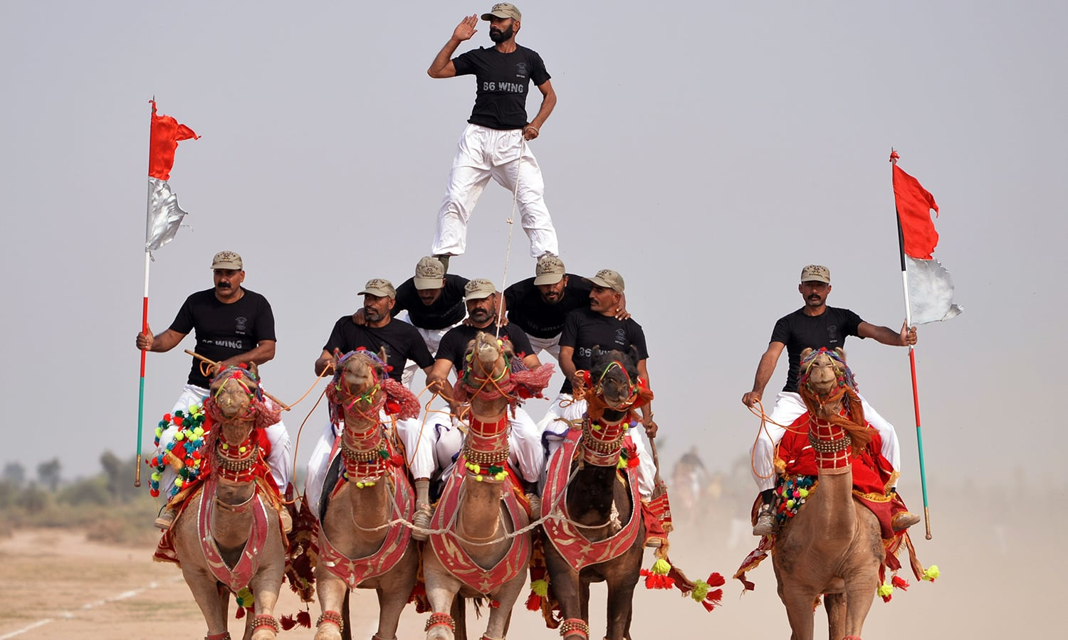 In this photograph taken on November 13, 2015, members of Pakistan Desert Rangers, perform during a march in Moj Garh, 100 kilometres east of Bahawalpur in Punjab province. —AFP