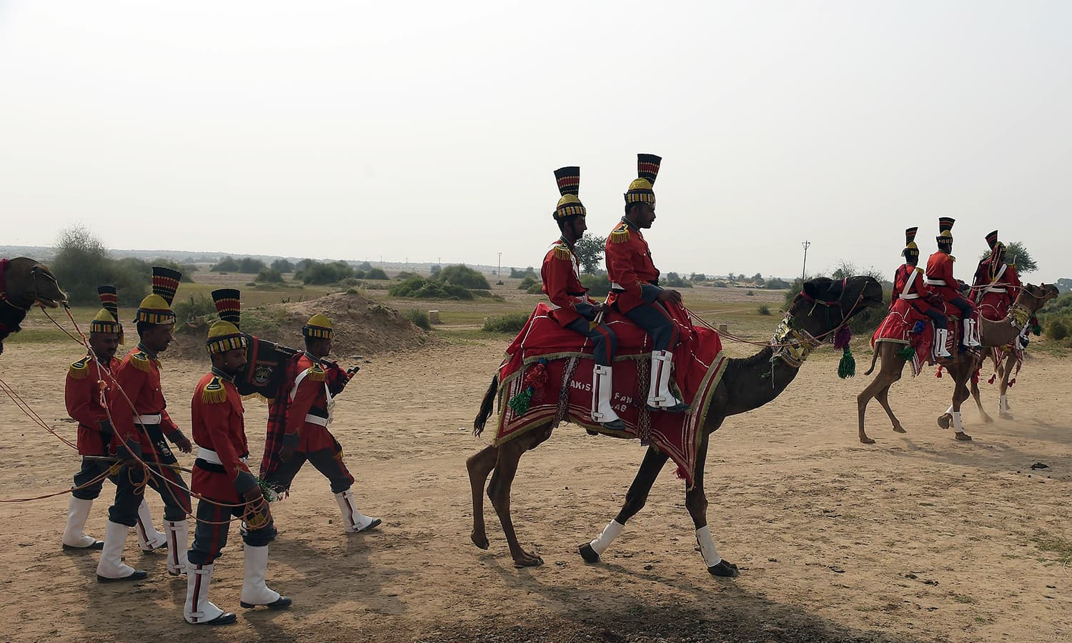 In this photograph taken on November 13, 2015, band members of Pakistan Desert Rangers, arrive after performing in Moj Garh, some 100 kilometres east of Bahawalpur in Punjab province. —AFP