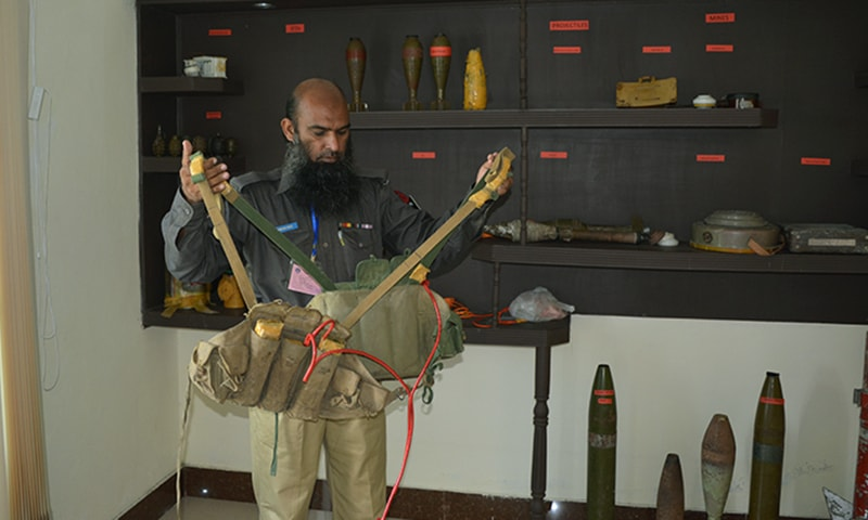 A trainee, Zameer Khan, demonstrates how to defuse a suicide jacket at PSEH. — Photo by author