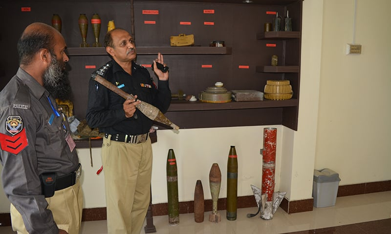 Inspector Shafiq showing different kinds of rockets. — Photo by author