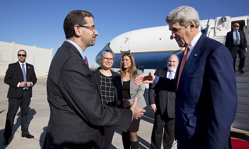 US Secretary of State John Kerry (R) is greeted by US Ambassador to Israel, Daniel Shapiro, upon his arrival in the Israeli coastal city of Tel Aviv on November 24, 2015. —AFP