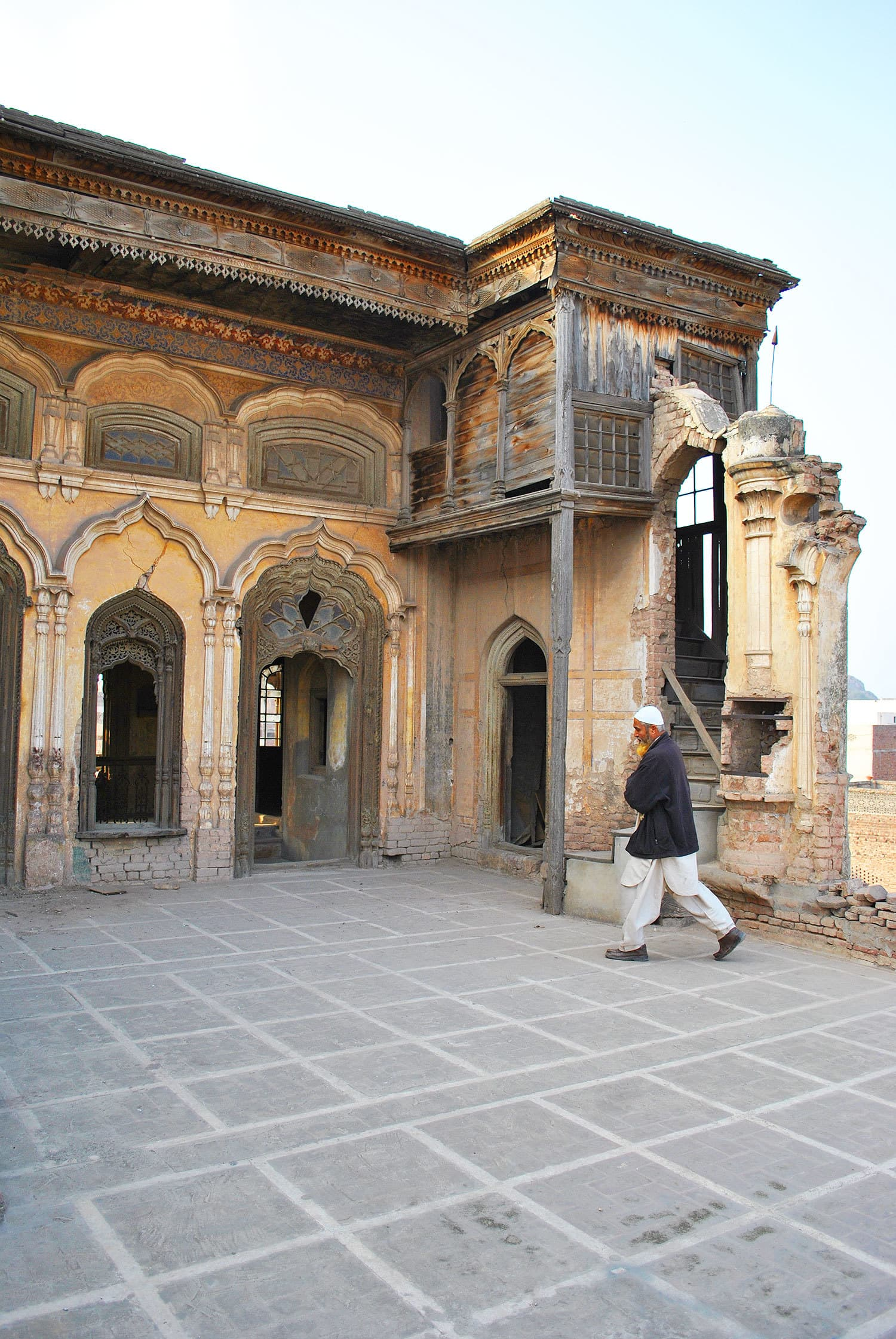 Mushtaq Ahmad — the librarian, guide, curator, historian and caretaker of the two graves inside the palace.