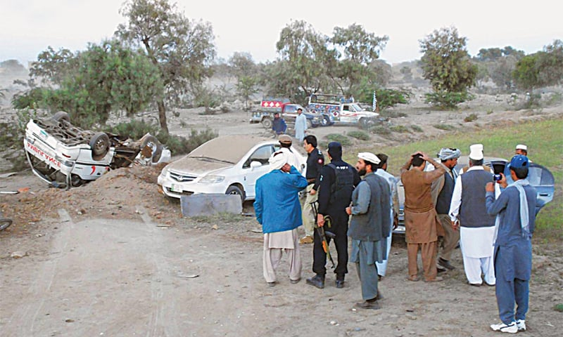 BANNU: Officials inspect the site where a convoy of Minister for Housing and Works Akram Khan Durrani came under attack on Thursday.—Online