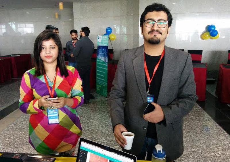Patari's Humayun Haroon with a team member.