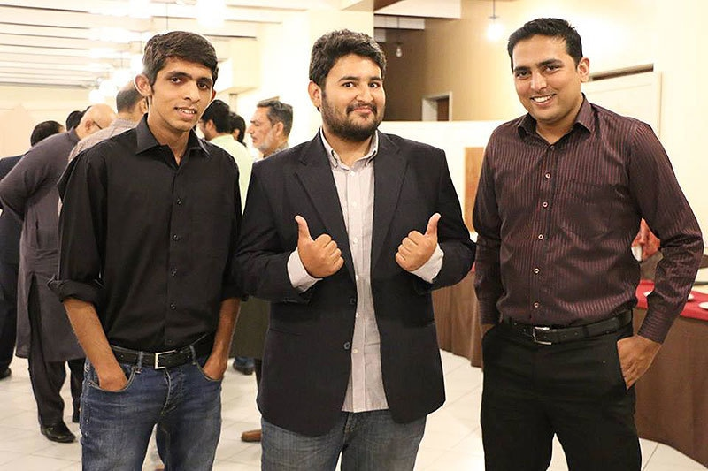 Auto Genie's Abdullah Cheema with his team.