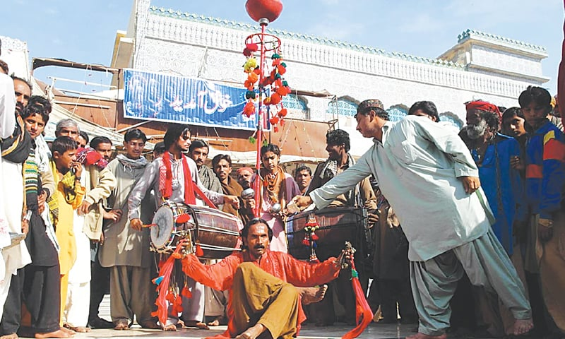 A DEVOTEE dances to the beat of a drum as the Urs of Hazrat Shah Abdul Latif Bhitai began on Friday.—Online