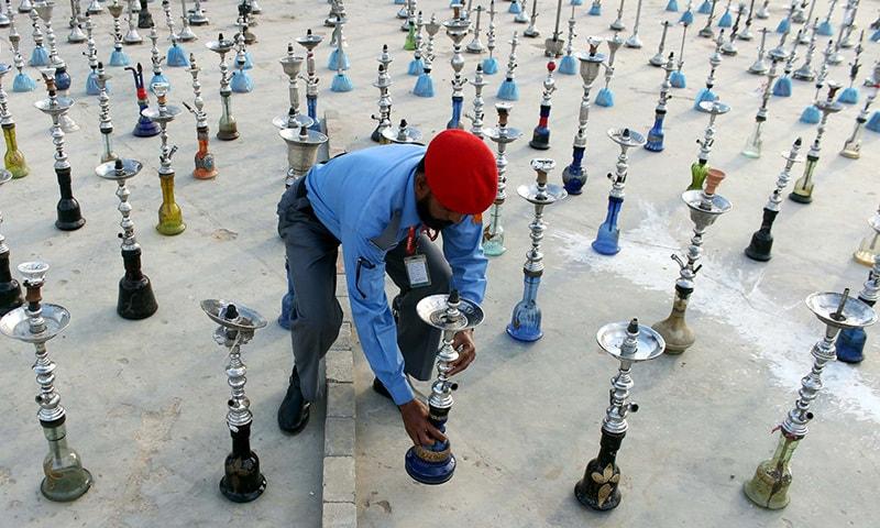 Shisha, tobacco seized in DHA destroyed - Pakistan - DAWN COM