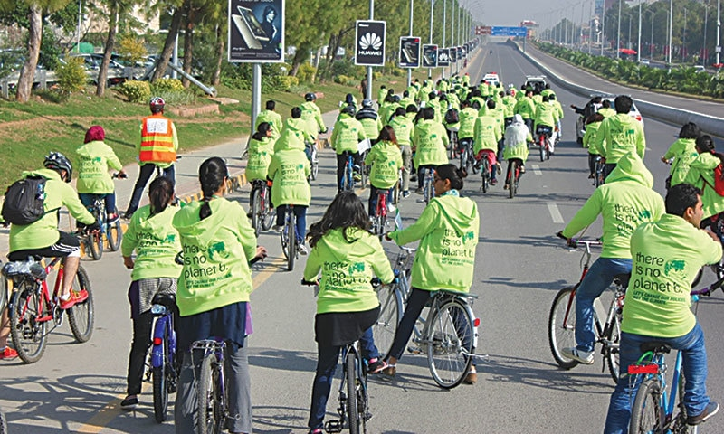 Young people of Islamabad wearing the There is no Planet B pullovers.—Photo by author