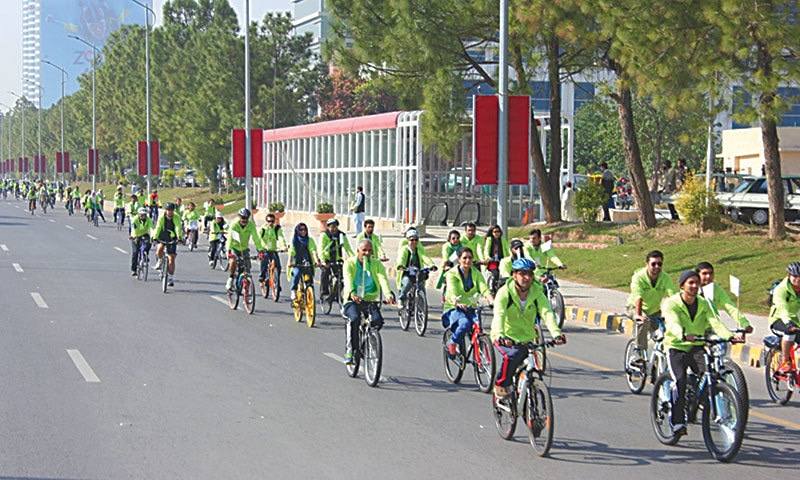 Islamabad's youth cycling on Jinnah Avenue during the Go Green Rally. —Photo by author