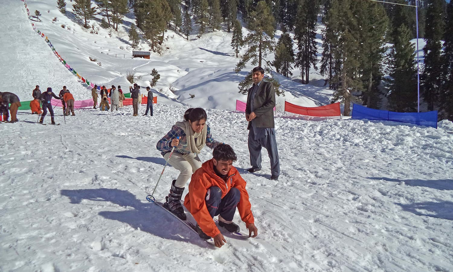 A tourist learning how to ski from a local skier at Malam Jabba.  — Photo by author