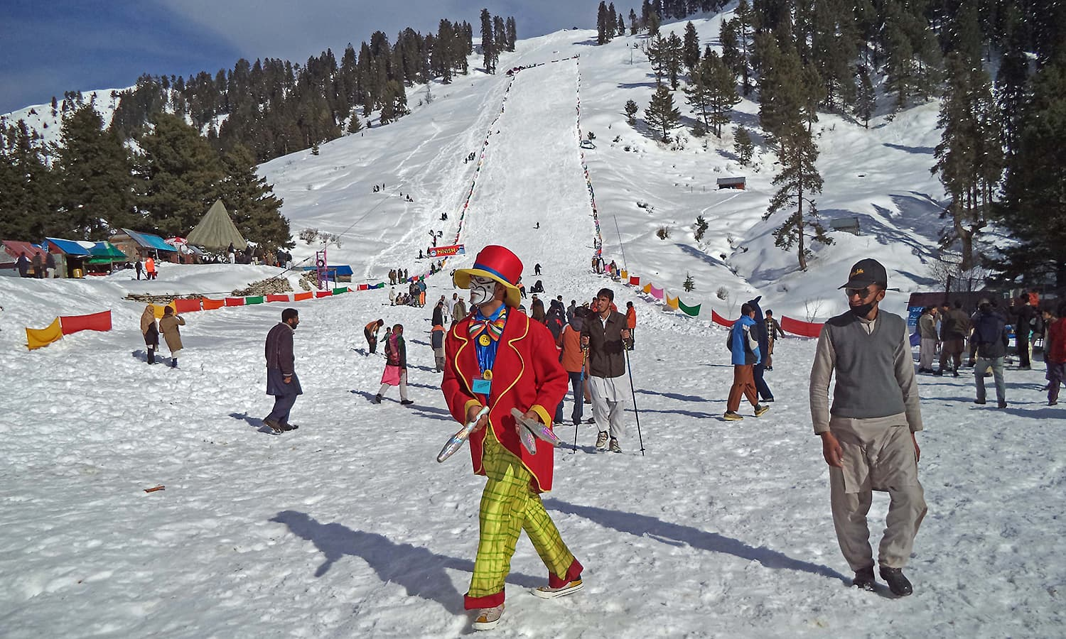 An entertainer is walking at the end of the ski slope in Malam Jabba.  — Photo by author