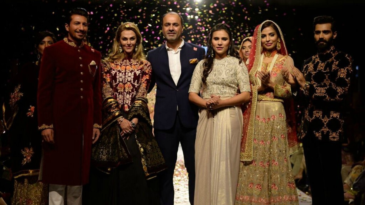 The designer poses with his showstoppers: Sana Bucha, Wiqar Ali Khan and Zoe Viccaji