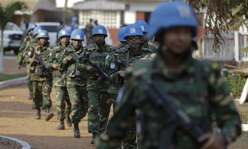 UN peacekeeping soldiers from Bangladesh arrive at the evangelical theological school of Bangui, Central African Republic, prior to Pope Francis' visit. ─ AP