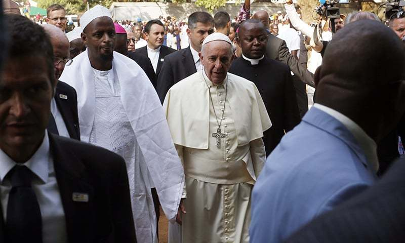 Pope Francis is welcomed by Imam Tiding Moussa Naibi (L) on the occasion of his visit at the Central Mosque in Bangui's Muslim enclave of PK5. ─ AP