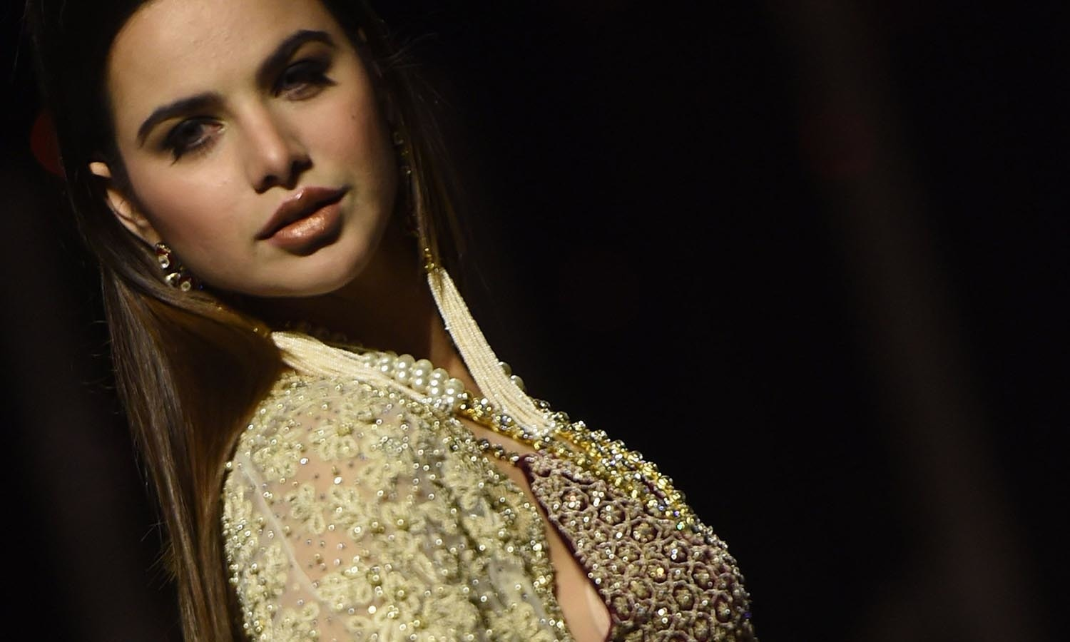 A model presents a creation by designer Shehla on the first day of the Pakistan Fashion Week in Karachi. — AFP