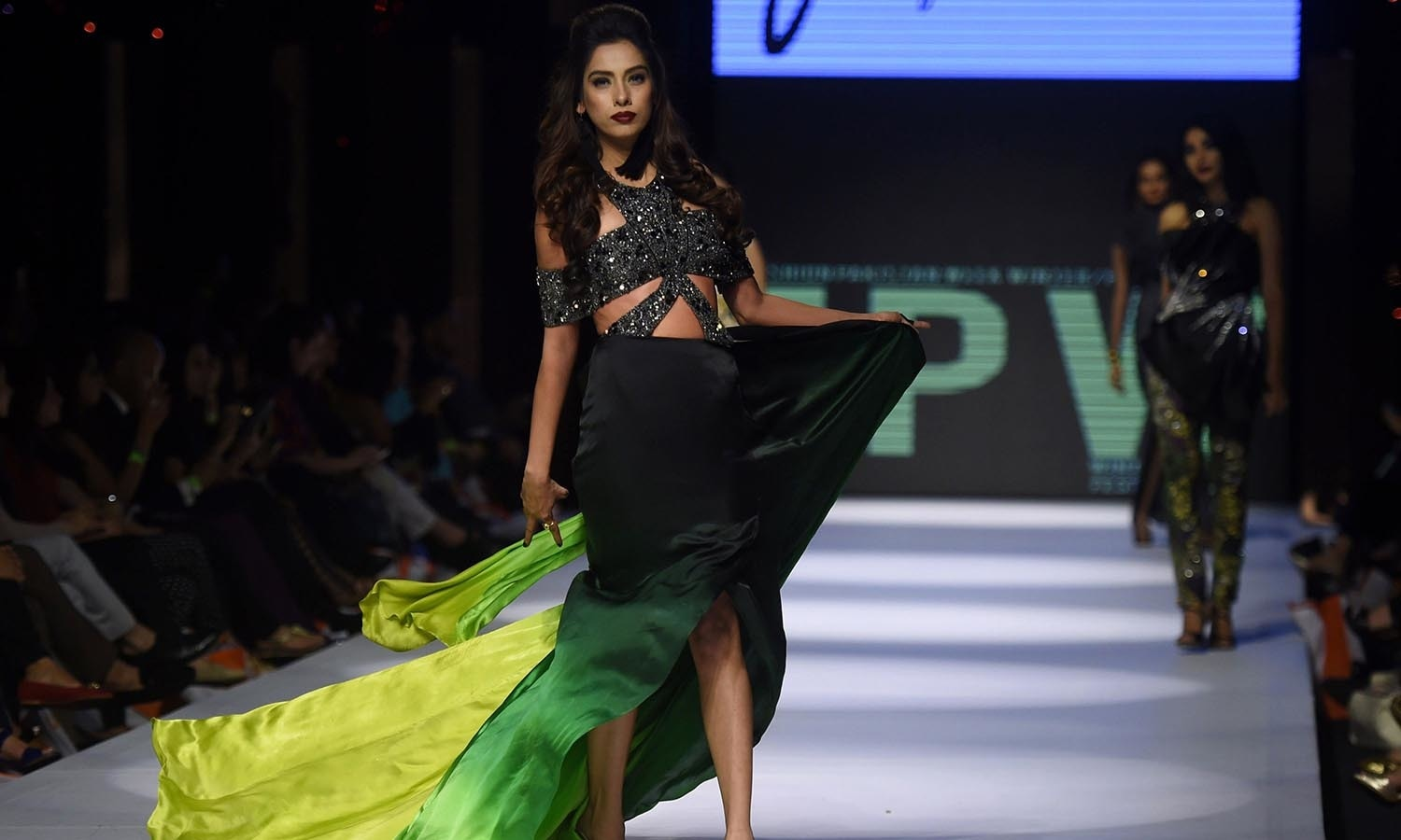 A model presents a creation by designer Ayesha Farook Hashwani on the first day of the Fashion Pakistan Week in Karachi. — AFP