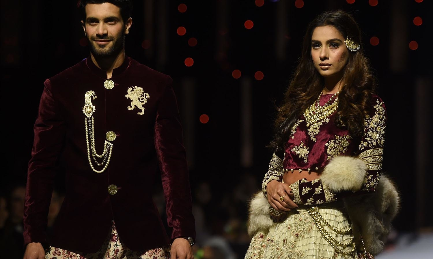 Models present creations by designer Shehla on the first day of the Pakistan Fashion Week in Karachi. — AFP