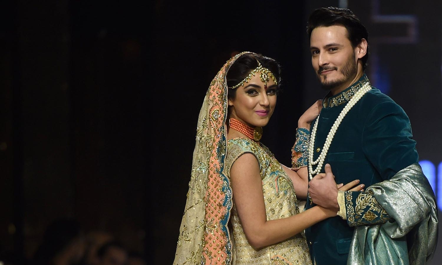 Models present creations by  designer Wardha Saleem on the second day of the Fashion Pakistan Week in Karachi. — AFP