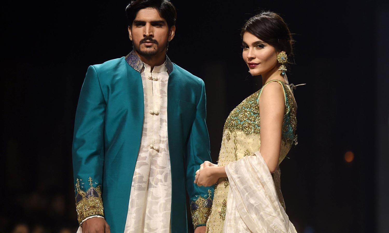 Models present creations by  designer Obaid Shiekh on the second day of the Fashion Pakistan Week in Karachi. — AFP