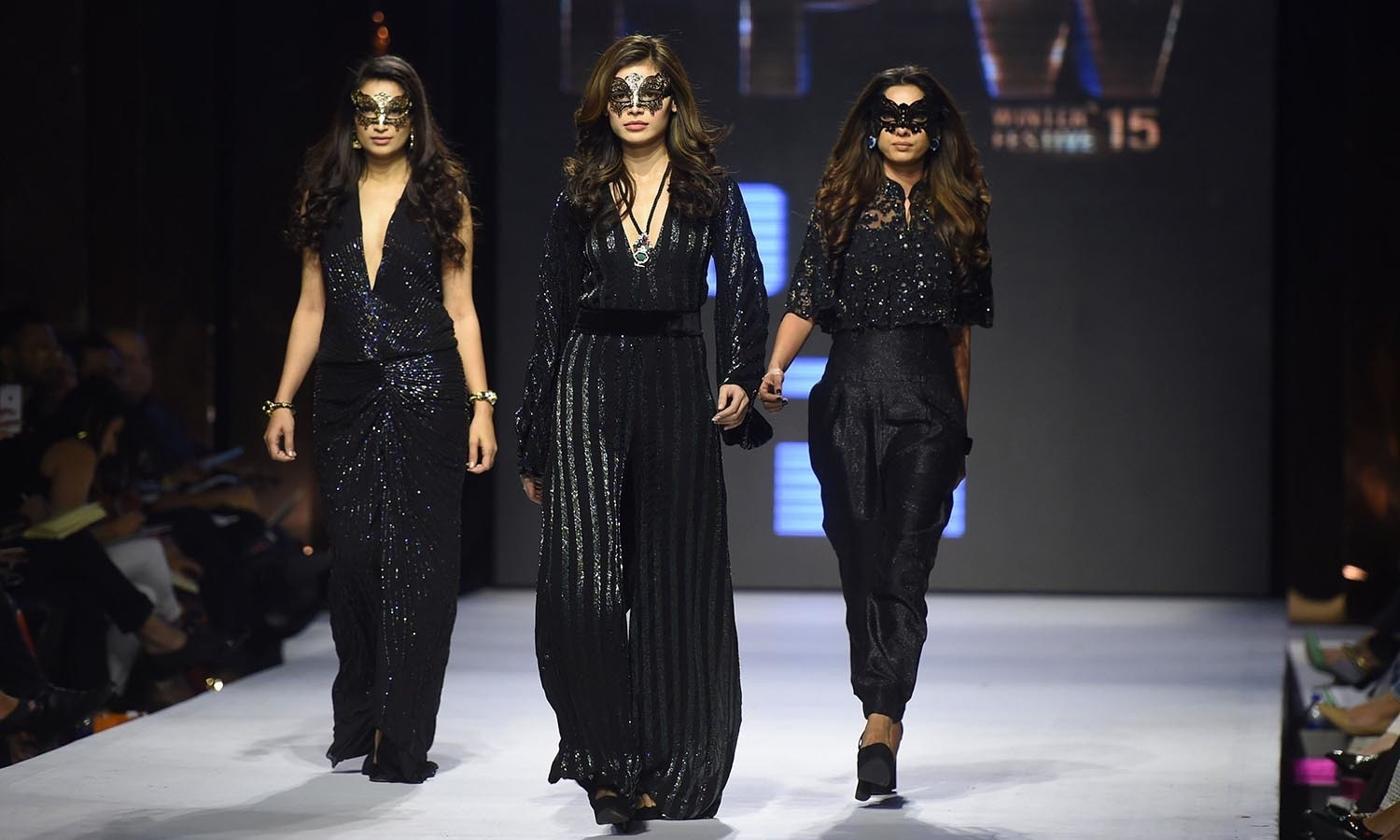 Models present creations by  designer Maheen Karim on the second day of the Fashion Pakistan Week in Karachi. — AFP