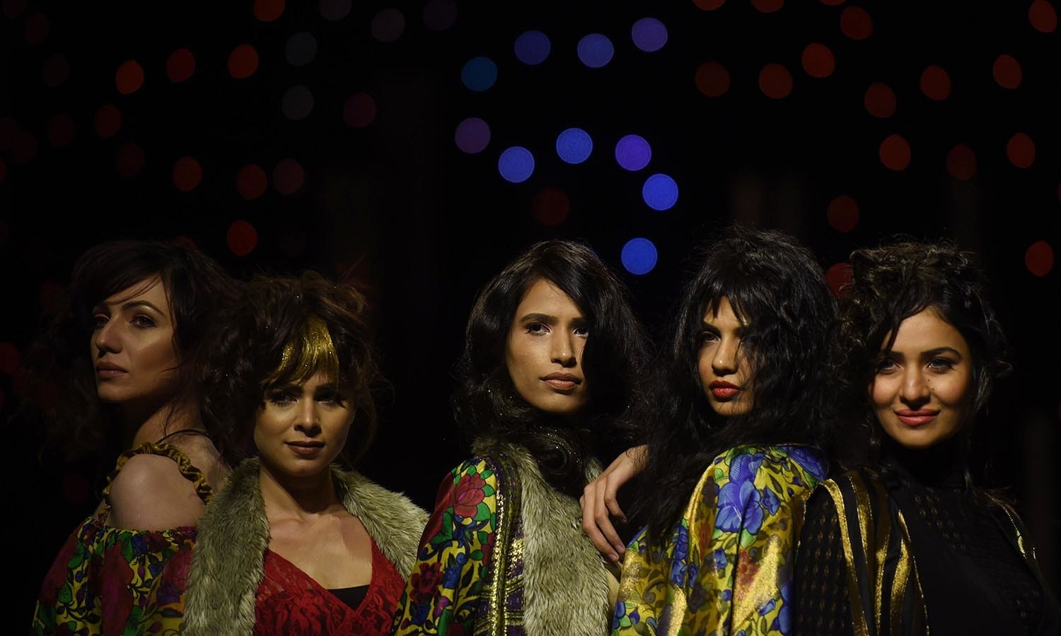 Models present creations by designer Tony&Guy on the first day of the Fashion Pakistan Week in Karachi. — AFP