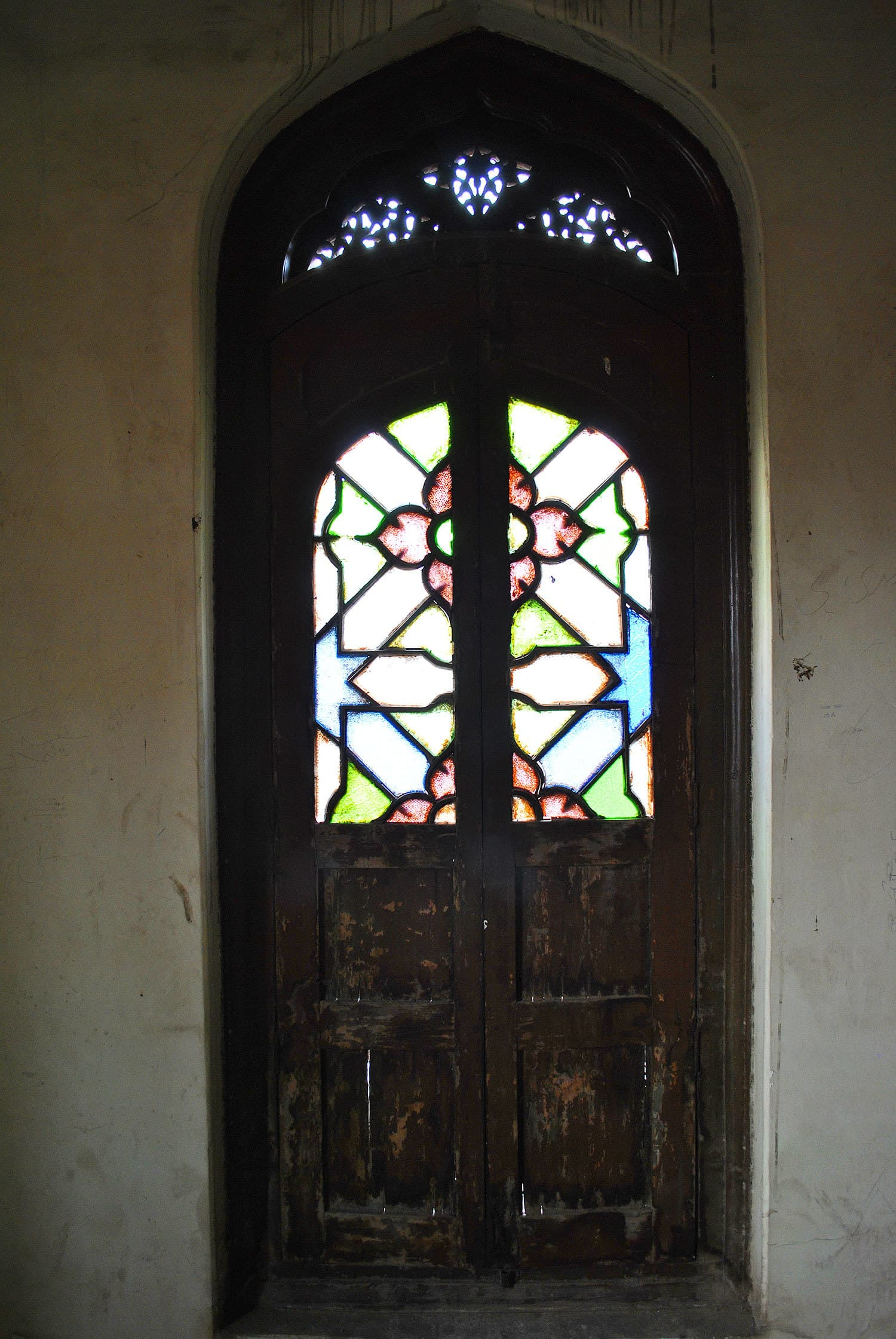 A door with stained glass work.