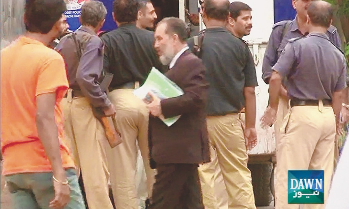 A screen grab from Dawn News footage taken at the time of the arrest of Shoaib Warsi, deputy managing director at the Sui Southern Gas Company