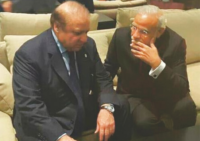 PARIS: Prime Minister Nawaz Sharif and his Indian counterpart Narendra Modi pictured during their brief meeting here on Monday.—INP