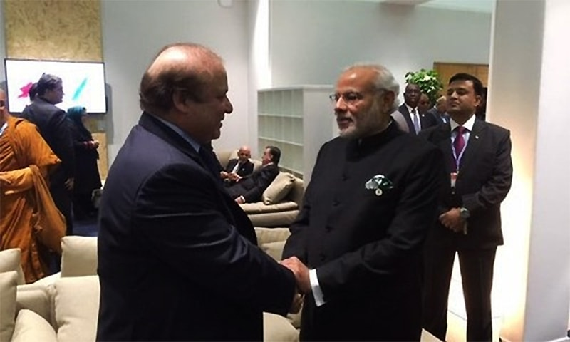 Prime Minister Nawaz Sharif and his Indian counterpart Narendra Modi greet each other. ─ Photo courtesy: MEA