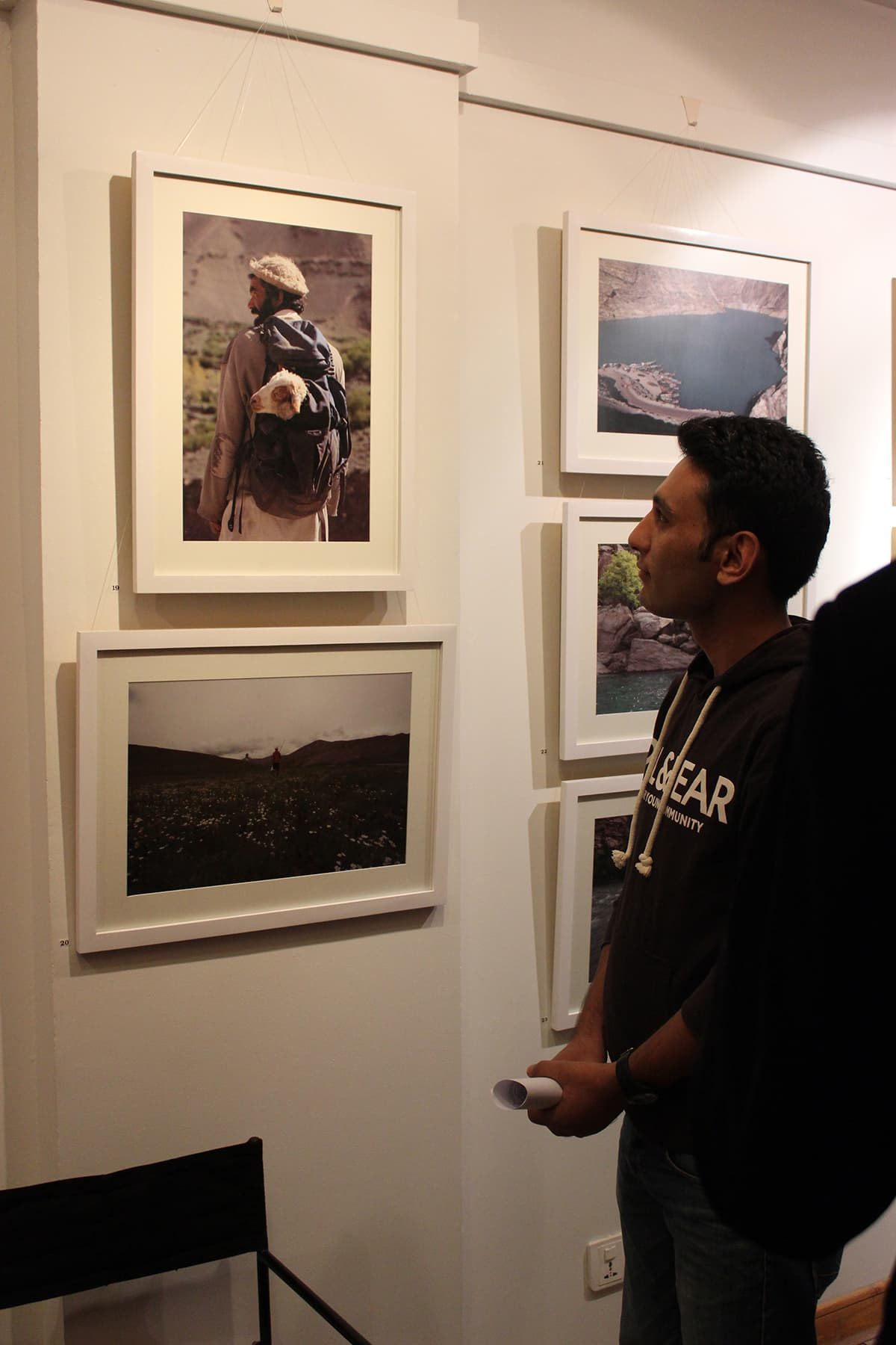 A visitor looks at Danial's work. — Photo by Ibtisam Khanzada