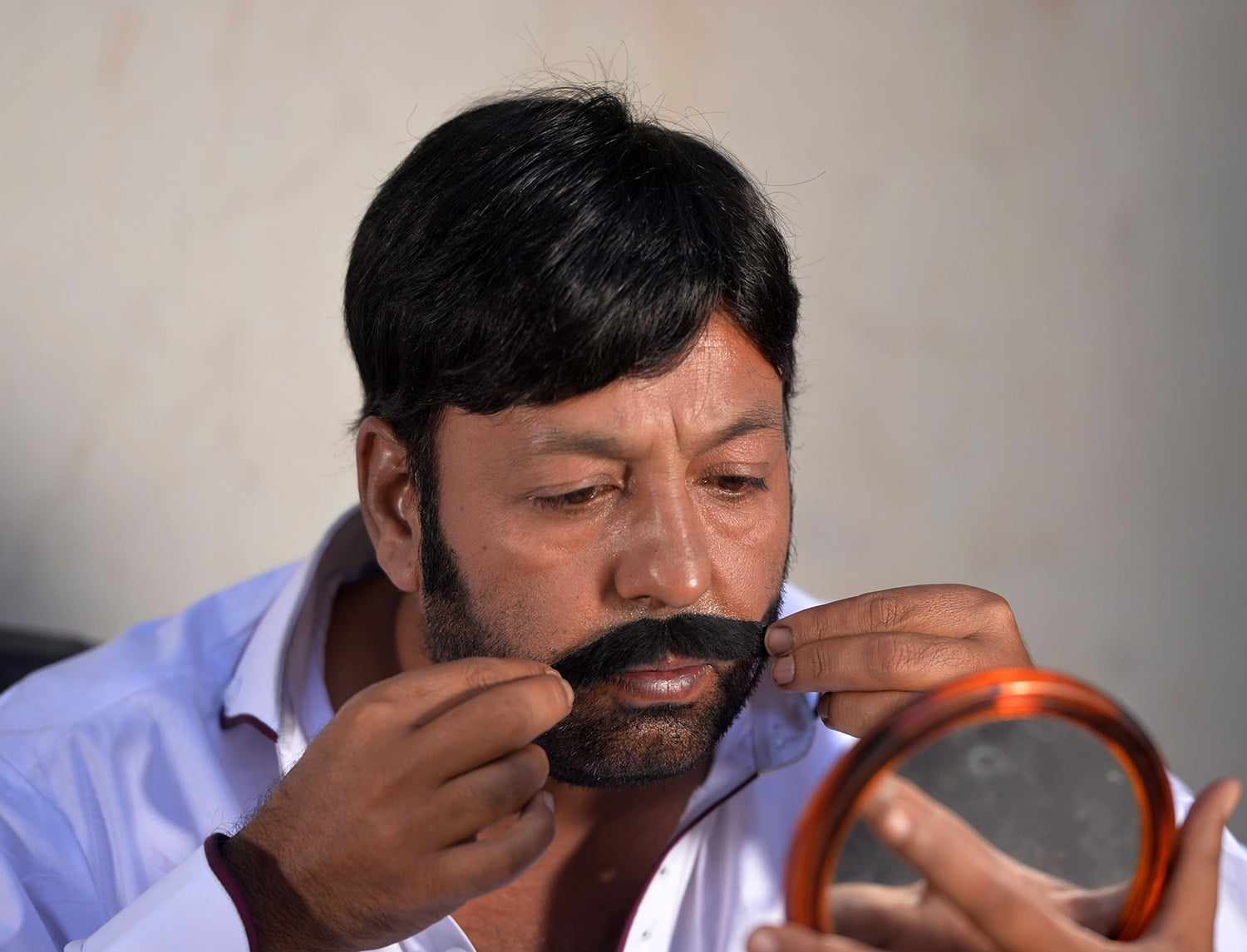 In This Photograph Taken On June 9 2015 Actor Shahid Khan Adjusts His Moustache